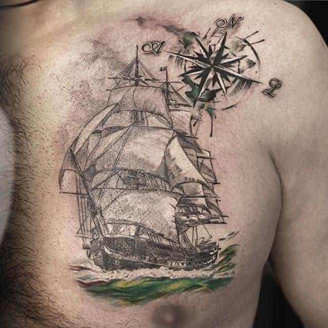 тату на груди корабль
