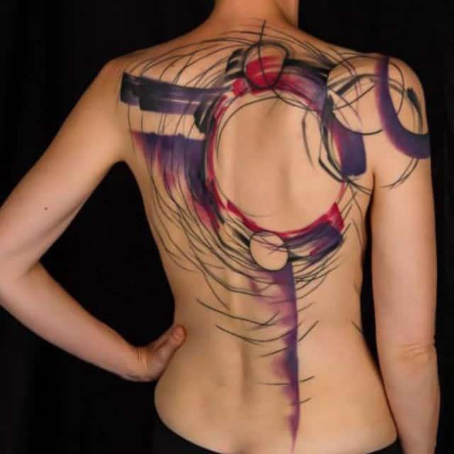 Абстракция тату на спине