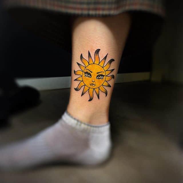 тату желтое солнце