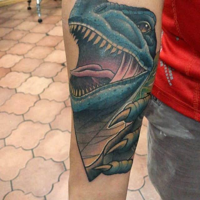 тату динозавр синий