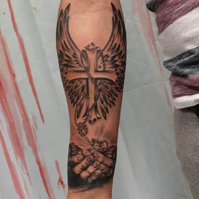 крест тату с крыльями