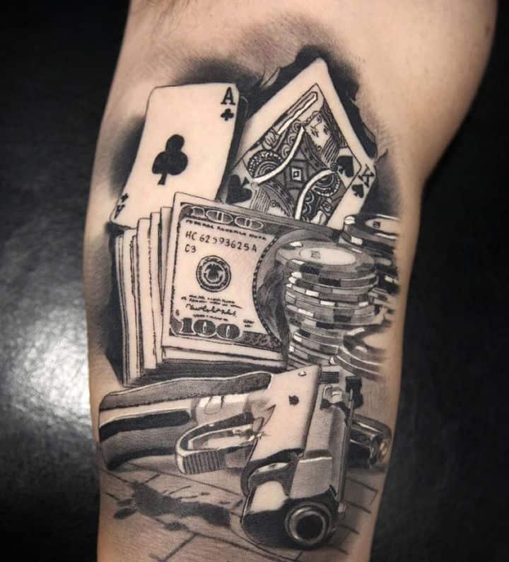карты деньги пистолет татуировка